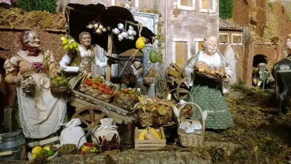 Jouluseimessä Jeesus-lapsi on syntynyt torikaupan hälinään.